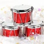 Three Red Christmas Drums with snowy background
