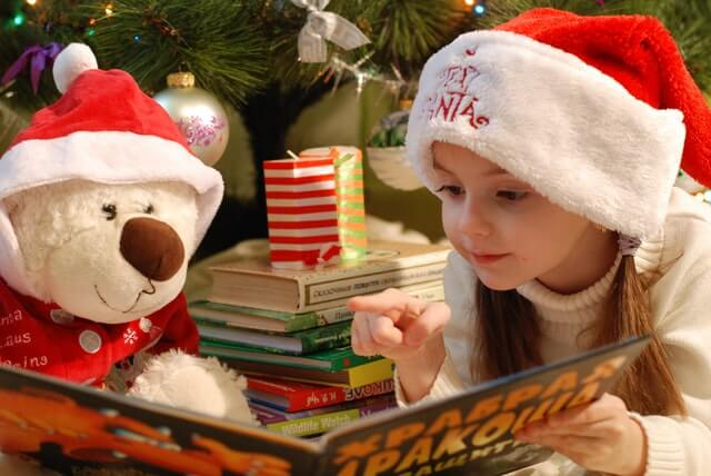 christmas scene with child reading to a stuffed bear - All I Want For Christmas Is My Two Front Teeth