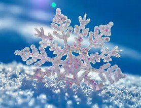 A beautiful white snowflake with a blue background.